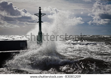 Lantern and Storm in baltic sea - stock photo