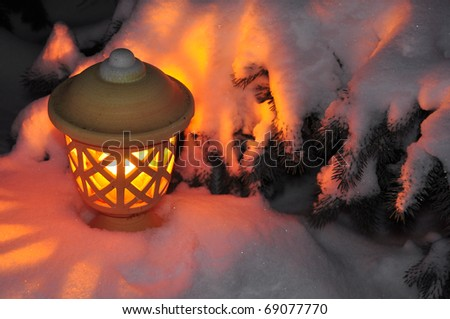 lantern at snow - stock photo