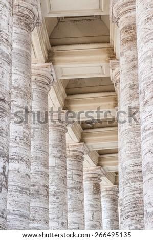 Lantern in Bernini's colonnade, St Peter's Basilica (Basilica Papale di San Pietro in Vaticano) in Vatican City, Rome, Italy - stock photo