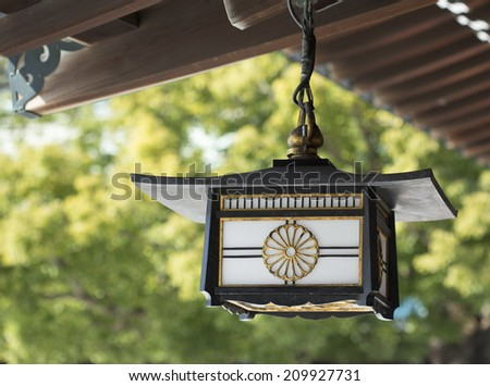 Lantern in Tokyo's Meiji shinto shrine. - stock photo