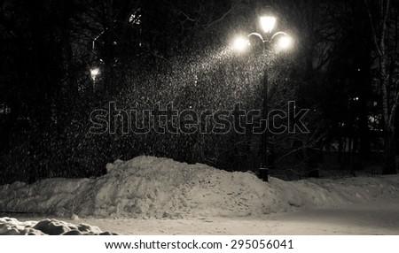 lantern light through the blizzard night - stock photo