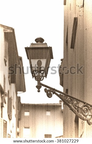 Lantern of lighting streets of Bologna, Italy, Old style. Sepia - stock photo