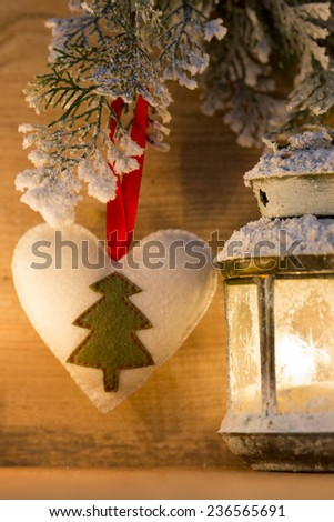 Lantern on a snowy background. Christmas decor. Christmas scene.