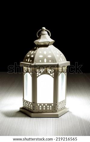 Lantern on the bright wood background - stock photo