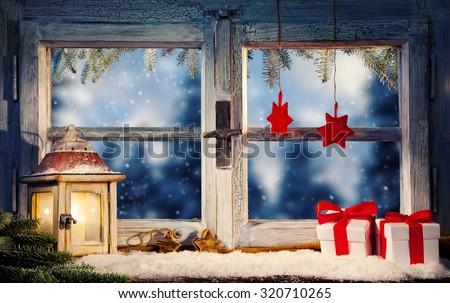 Lantern on window sill in winter mood - stock photo
