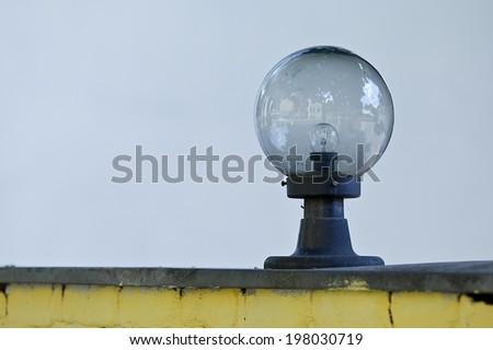 lantern street light on grey background - stock photo
