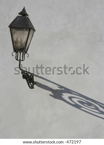 lantern with shadow on concrete wall