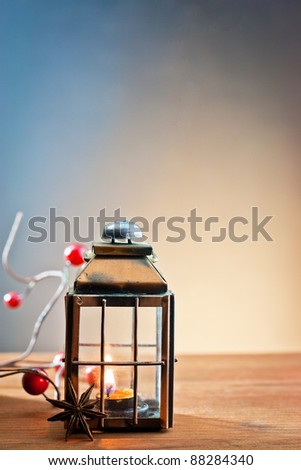 lantern with the flame in Christmas ambien - stock photo