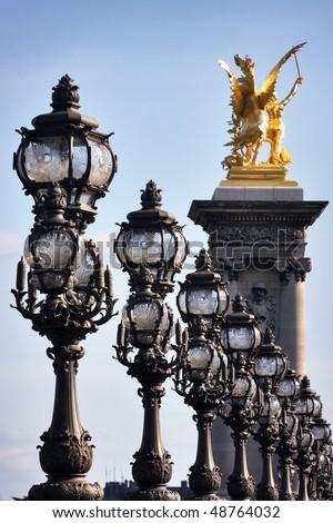 Lanterns and sculpture on Alexander's bridge of the third in Paris - stock photo