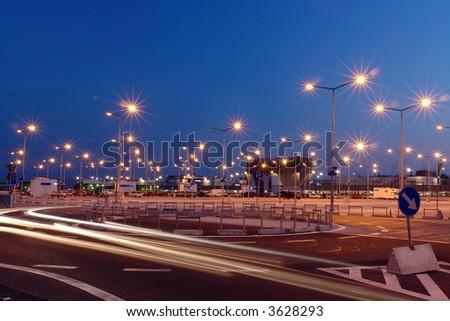 Lanterns at shopping mall parking lot illuminated at night - stock photo