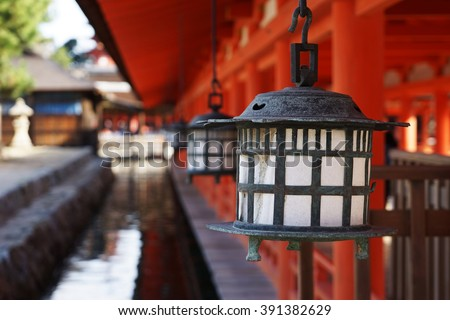 Lanterns in Itsukushima Shrine,  Miyajima, Hiroshima Prefecture, Japan. - stock photo