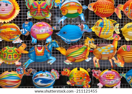 Lanterns in the market sale for Mid-Autumn festival ( Trung Thu ) in cho lon, Ho Chi Minh City, Vietnam. People in a few Asian country like to buy lanterns for their children at Mid Autumn festival. - stock photo