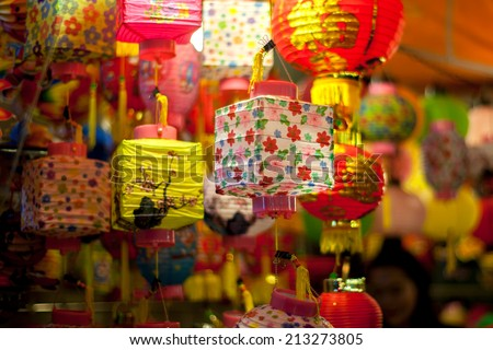 Lanterns in the market sale for Mid-Autumn festival (Trung Thu) in cho lon, Ho Chi Minh City, Vietnam. Parents often buy lanterns for their children in this occasion. - stock photo
