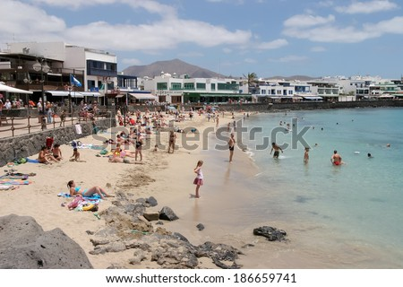 Lanzarote Canary Islands Spain August  People Enjoying The Beach And Sea