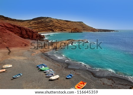 Lanzarote El Golfo Atlantic ocean beached boats in Canary Islands - stock photo