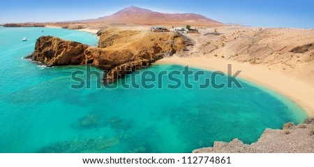 Lanzarote Papagayo turquoise beach and Ajaches in Canary Islands - stock photo