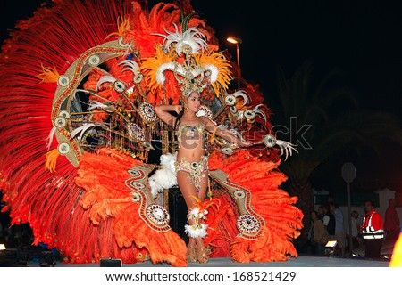 LANZAROTE, SPAIN - March 2: The Carnival Queen in costumes at the Grand Carnival Parade on march 2, 2013 in Costa Teguise, Lanzarote, Canaries Islands, Spain.  - stock photo