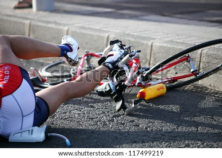 LANZAROTE, SPAIN - MAY 19: An unnamed rider fell of with bike during race in ironman Triathlon 2012 Event May 19 2012, in Lanzarote, Spain. - stock photo