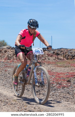 "LANZAROTE, SPAIN - MAY 03: Maria del Pilar N345 in action at Adventure mountain bike marathon ""Ultrabike Santa Rosa"" May 03, 2015. Lanzarote, Canaries islands, Spain. - stock photo"