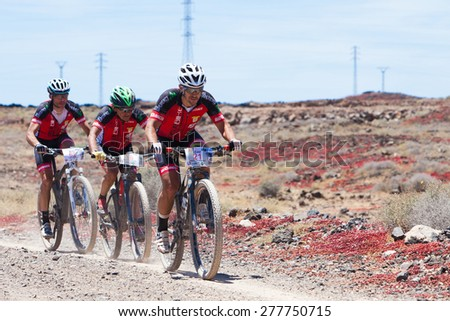"LANZAROTE, SPAIN - MAY 03: Mariano Aguado N21, Antonio Acosta N18 in action at Adventure mountain bike marathon ""Ultrabike Santa Rosa"" May 03, 2015. Lanzarote, Canaries islands, Spain. - stock photo"
