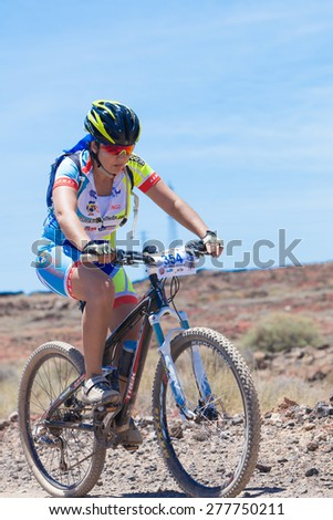 "LANZAROTE, SPAIN - MAY 03: Regina Santana (N354) in action at Adventure mountain bike marathon ""Ultrabike Santa Rosa"" May 03, 2015. Lanzarote, Canaries islands, Spain. - stock photo"