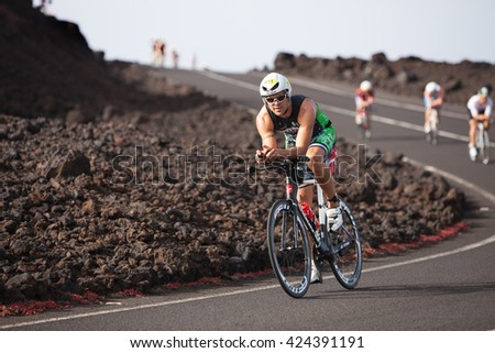 LANZAROTE, SPAIN - MAY 21: Sportsman Rub�©n Cabrera Brito (611 ESP) rides a bike during the IRONMAN LANZAROTE triathlon on May 21, 2016 in Tamanfaya, Lanzarote, Las Palmas, Canary Islands, Spain