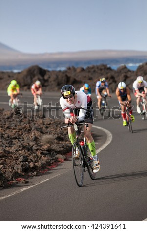 LANZAROTE, SPAIN - MAY 21: Sportsman Wilm Schneider(799,GER) leads  a group of rides   during the IRONMAN LANZAROTE triathlon on May 21, 2016 in Tamanfaya, Lanzarote, Las Palmas, Canary Islands, Spain - stock photo