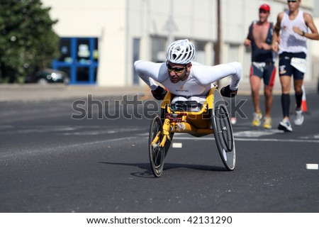 LANZAROTE , SPAIN - NOVEMBER 29: Disabled athlete in a sport wheelchair during 2009 Lanzarote marathon on November 29, 2009 in Lanzarote, Spain. - stock photo