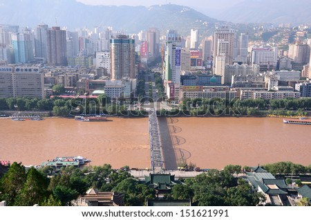 LANZHOU, CHINA - JULY 31:  Lanzhou city on July 31, 2013 in Lanzhou, China. Lanzhou is the capital of Gansu Province and 1600 meters above sea level.The Yellow River flows through from west to east. - stock photo