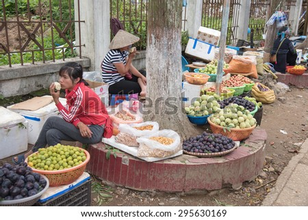 Lao cai, Vietnam - June 16, 2015: Unidentified women are selling local fruit on 16 June 2015. Lao cai, Vietnam