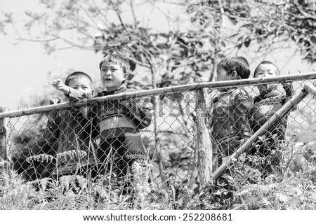 LAO CHAI VILLAGE, VIETNAM - SEP 22, 2014: Unidentified Hmong little children in a village Lao Chai in Vietnam. Hmong is on of the minority eethnic group in Vietnam - stock photo