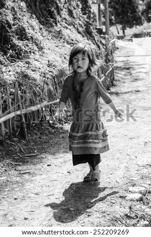 LAO CHAI VILLAGE, VIETNAM - SEP 22, 2014: Unidentified Hmong little girl in a village Lao Chai in Vietnam. Hmong is on of the minority eethnic group in Vietnam - stock photo