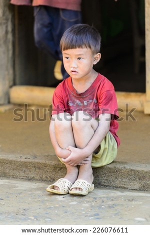 LAO CHAI VILLAGE, VIETNAM - SEP 22, 2014: Unidentified Hmong little shy boy on a break in a local primary school. Hmong is on of the minority eethnic group in Vietnam - stock photo