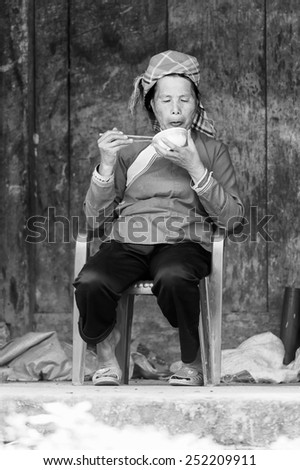 LAO CHAI VILLAGE, VIETNAM - SEP 22, 2014: Unidentified Hmong woman sits on a chair in Lao Chai. Hmong is on of the minority eethnic group in Vietnam