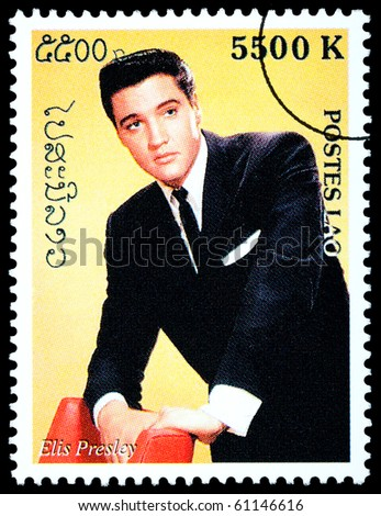 LAOS - CIRCA 2000: A postage stamp printed in Laos showing Elvis Presley, circa 2000 - stock photo