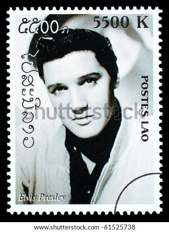 LAOS - CIRCA 1999: A postage stamp printed in Laos showing Elvis Presley, circa 1999 - stock photo