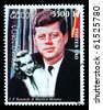 LAOS - CIRCA 1999: A postage stamp printed in Laos showing John F. Kennedy, circa 1999 - stock photo