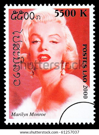 LAOS - CIRCA 1999: A postage stamp printed in Laos showing Marilyn Monroe, circa 1999 - stock photo