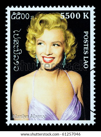 LAOS - CIRCA 2000: A postage stamp printed in Laos showing Marilyn Monroe; circa 2000 - stock photo