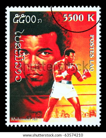 LAOS - CIRCA 1999: A postage stamp printed in Laos showing Muhammad; Ali, circa 1999 - stock photo