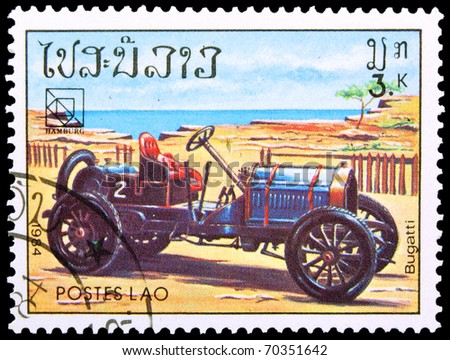 LAOS - CIRCA 1984: A stamp printed in Laos showing vintage car, circa 1984 - stock photo