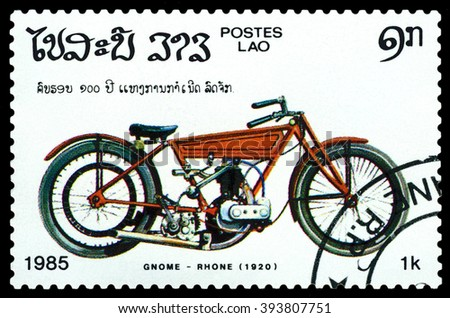 LAOS - CIRCA 1985: A stamp printed in Laos shows old motorcycle Gnome - Rhone. 1920, France , stamp devoted to the centenary of the invention of motorcycle , cirka 1985 - stock photo