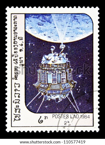 "LAOS- CIRCA 1985: A stamp printed in Laos shows Soviet spacecraft ""Luna 3"" and Moon without inscription, from the series ""Space Exploration"", circa 1985 - stock photo"