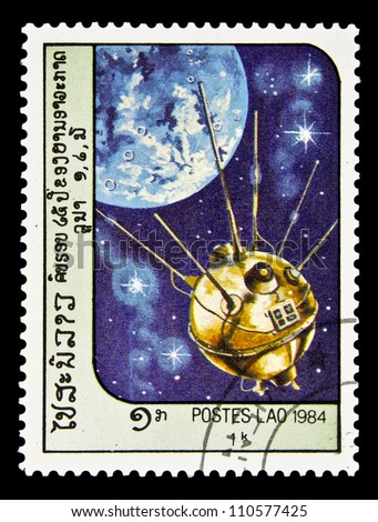 "LAOS- CIRCA 1985: A stamp printed in Laos shows Soviet spacecraft ""Luna 2"" and Moon without inscription, from the series ""Space Exploration"", circa 1985 - stock photo"