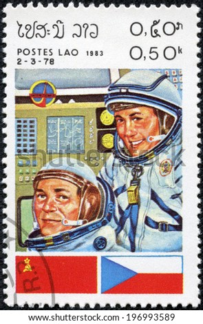 LAOS-CIRCA 1983: A stamp printed in the Laos, a symbol INTERCOSMOS - Space Cooperation Program of the USSR - Czechoslovakia, circa 1983 - stock photo