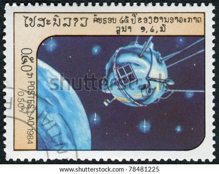 LAOS-CIRCA 1984: A stamp printed in the Laos, depicts the spacecraft Luna 1, circa 1984 - stock photo