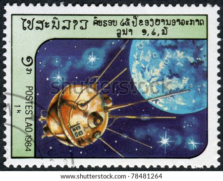 LAOS-CIRCA 1984: A stamp printed in the Laos, depicts the spacecraft Luna 2, circa 1984 - stock photo