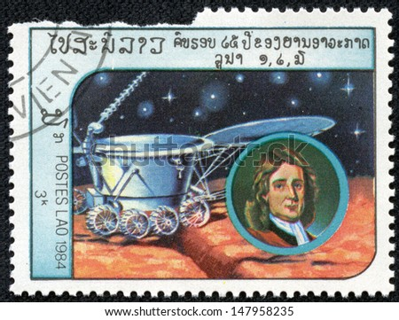 LAOS-CIRCA 1984: A stamp printed in the Laos, depicts the spacecraft Lunokhod-2 and a portrait of Isaac Newton, circa 1984 - stock photo