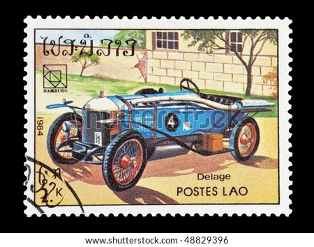 LAOS - CIRCA 1984: mail stamp printed in Laos featuring a vintage Delage sports car, circa 1984