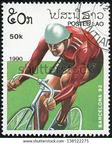 LAOS - CIRCA 1990: stamp printed by Laos, shows bicycling, circa 1990. - stock photo